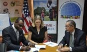 (From right to left) ?MOEYI Permanent Secretary, Dean-Roy Bernard; USAID Mission Director, Maura Barry Boyle; and USAID Program Director, James Burrowes, at the Safe Schools IL Signing.